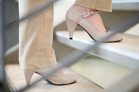 businesswoman legs: woman walking up stairs