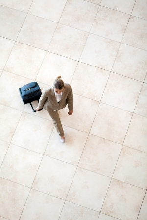 overhead: overhead view of young woman walking at airport Stock Photo