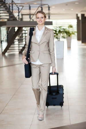 young businesswoman traveller walking at airport photo