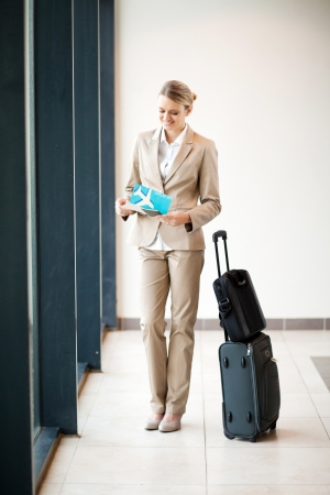corporate jet: young businesswoman waiting her flight at airport Stock Photo