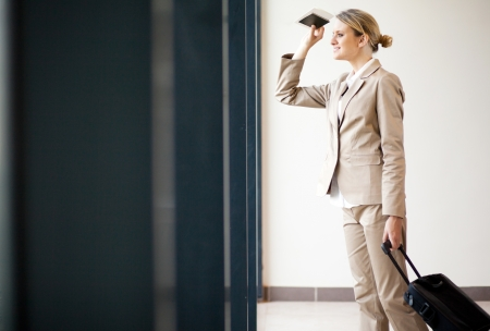 half dressed: young businesswoman waiting for flight at airport