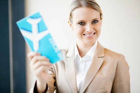 flight ticket: attractive young businesswoman holding air ticket