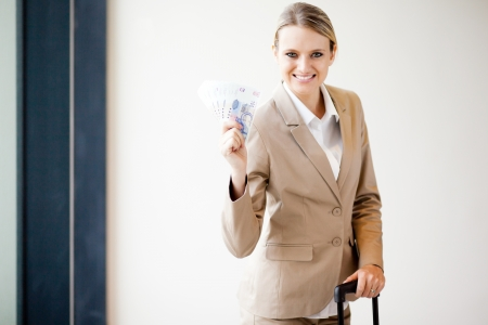 south african: young female business traveller holding South African money Stock Photo