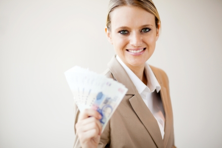 half dressed: beautiful young woman holding south african money