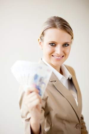 half dressed: attractive young businesswoman holding south african cash notes
