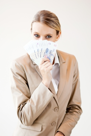 young south african woman holding cash note close to her face photo