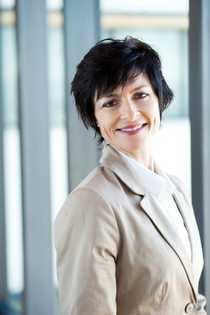 happy middle aged businesswoman portrait in office Stock Photo - 14898903