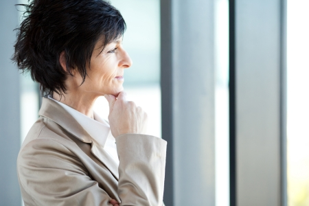thoughtful middle aged businesswoman closeup portrait photo
