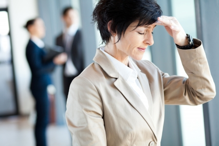 middle aged businesswoman having headache in office Stock Photo - 14899017