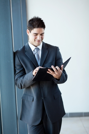 young businessman using tablet computer in office photo