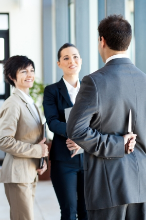 dangerous businessman hiding knife behind his back while handshaking with businesswoman Stock Photo - 14899040