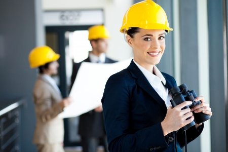 blue collar: female construction manager with binoculars Stock Photo