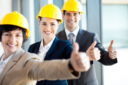executive helmet: group of construction manager thumbs up Stock Photo