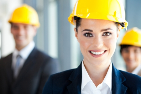 blue helmet: pretty and smart construction businesswoman closeup