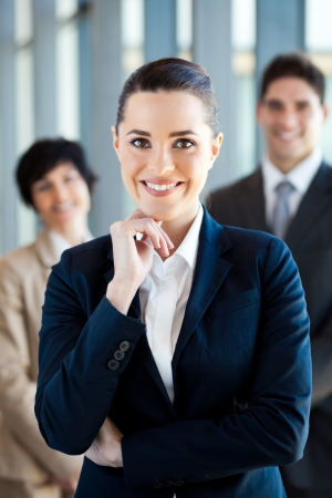 business leader: beautiful young businesswoman and team portrait