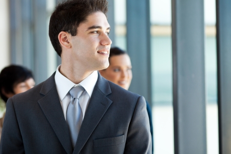 half dressed: young businessman looking outside office window Stock Photo
