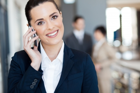 business woman phone: cute young businesswoman talking on cell phone Stock Photo