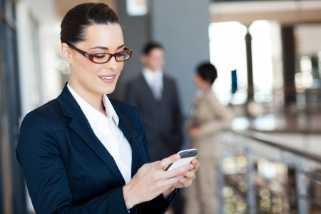 woman on cell phone: pretty businesswoman using smart phone Stock Photo