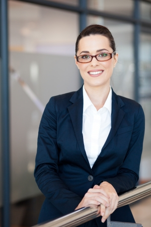 blue collar: beautiful young businesswoman portrait in office Stock Photo
