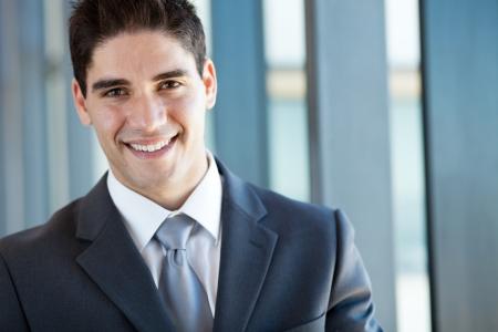 handsome businessman closeup portrait in office photo