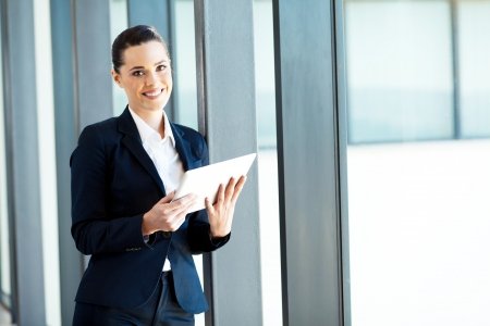 navy blue suit: attractive young businesswoman using tablet computer Stock Photo