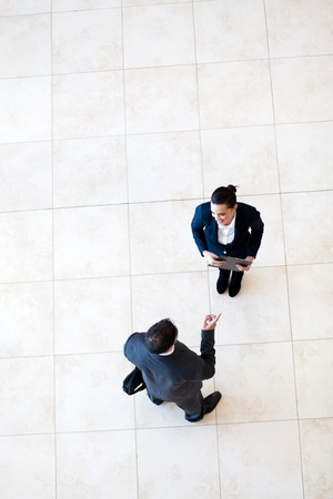 overhead view of businessman talking to businesswoman  photo