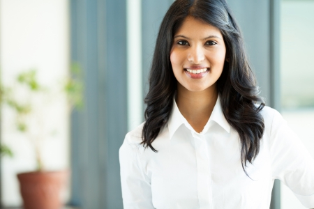 pretty young indian white collar worker in office Stock Photo
