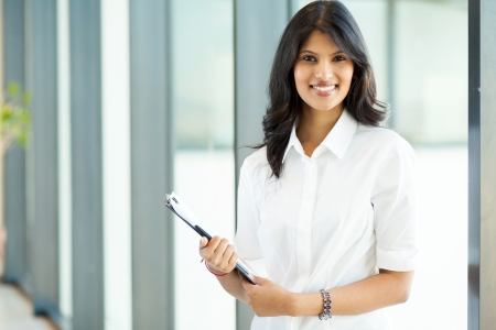 attractive modern young indian businesswoman in office photo
