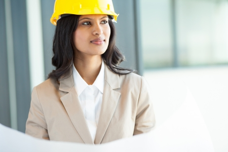 hat project: beautiful young indian architect in office Stock Photo