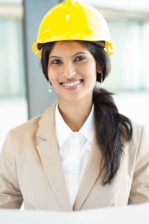 pretty young female construction worker in office photo