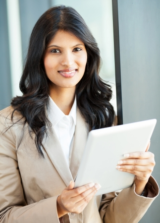 beautiful young indian businesswoman with tablet computer photo
