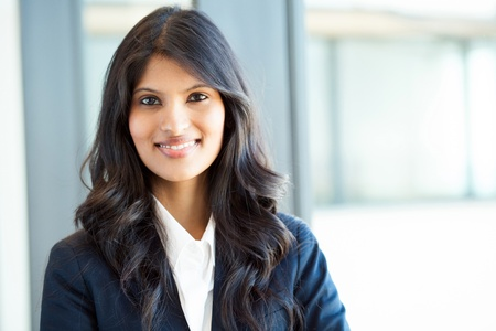 beautiful young indian businesswoman portrait in office photo