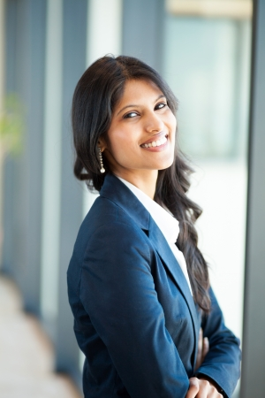 navy blue suit: cheerful young asian businesswoman in office Stock Photo
