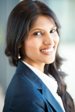 navy blue suit: attractive young asian businesswoman face closeup