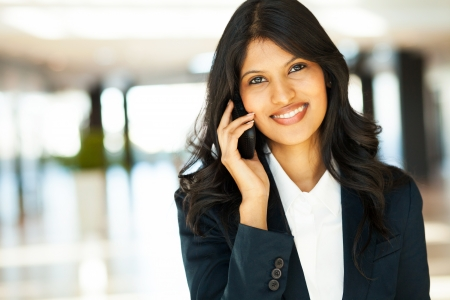phone professional: beautiful young indian businesswoman talking on cell phone