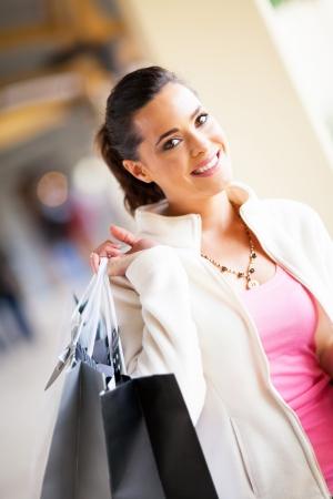 beautiful young woman shopping in mall Stock Photo - 15401599