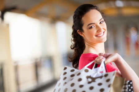 young woman carrying shopping bags in mall Stock Photo - 15401433