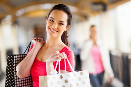 happy young woman with shopping bags Stock Photo - 15401620