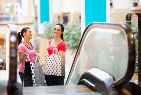 two happy young women in shopping mall Stock Photo - 15401437
