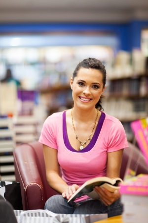 book shop: young woman reading book in bookstore