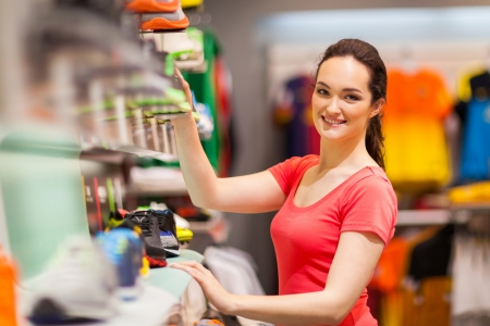 saleswomen: sportswear shop assistant portrait inside store Stock Photo