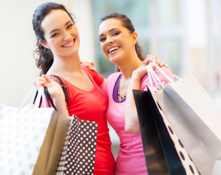 happy girls with shopping bags in mall Stock Photo - 15402469