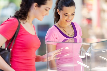two young women shopping for jewellery  Stock Photo - 15402307