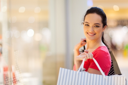 happy young woman shopping in mall photo