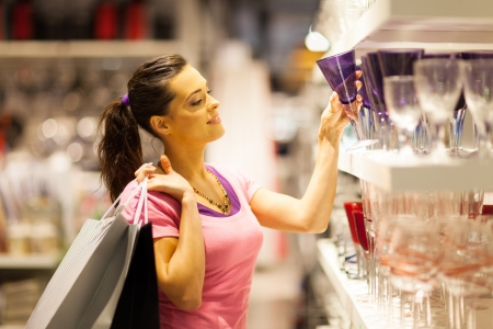 homeware: young woman shopping for glass