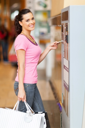 parking facilities: young woman paying for parking  Stock Photo