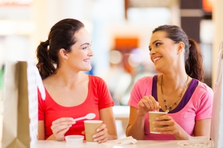 two happy friends having drinks in cafe Stock Photo - 15402470