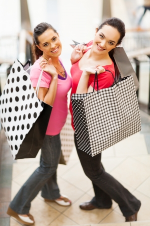 two happy young women with shopping bags Stock Photo - 15402268