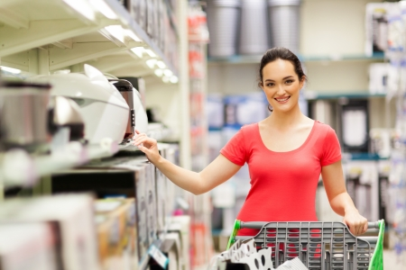 buy one: young woman shopping for appliance in supermarket Stock Photo