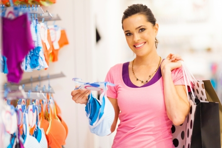 woman bra: young woman shopping for lingerie in clothing store